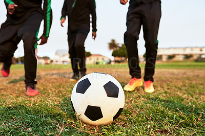 Buy stock photo Closeup shot of a group of young boys playing soccer on a sports field