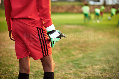 Buy stock photo Closeup shot of a young boy standing as the goalkeeper while playing soccer on a sports field