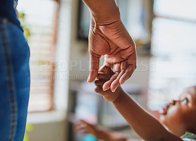 Buy stock photo Shot of an adorable little girl holding her mother's hand