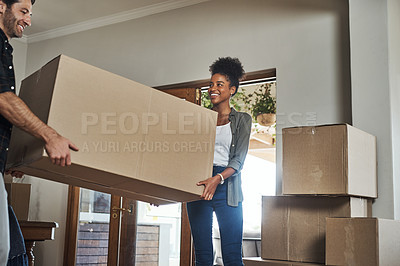 Buy stock photo Cropped shot of a couple carrying a big box into their new home