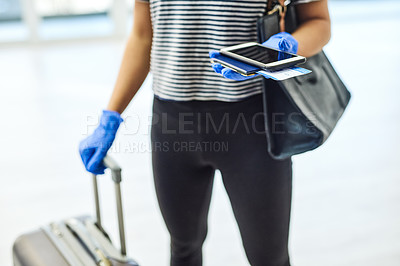 Buy stock photo Shot of an unrecognisable woman carrying her passport, smartphone and ticket in an airport