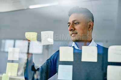 Buy stock photo Shot of a businessman having a brainstorming session in a modern office