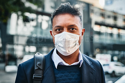 Buy stock photo Portrait of a businessman wearing a face mask against a city background