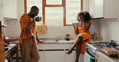 Buy stock photo Shot of a young couple enjoying a relaxing coffee break in the kitchen at home