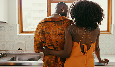 Buy stock photo Shot of a young couple sharing a romantic moment while washing the dishes at home