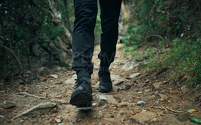 Buy stock photo Closeup shot of an unrecognisable man hiking through the mountains