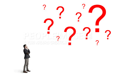 Buy stock photo Shot of a businessman looking up at question marks against a white background
