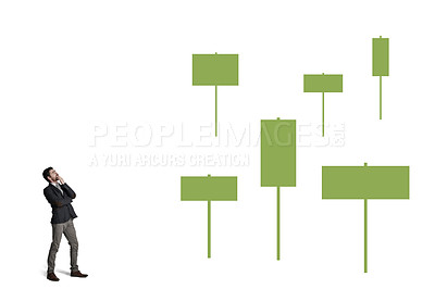 Buy stock photo Shot of a businessman looking thoughtfully at signs against a white background