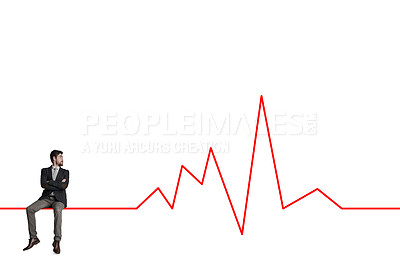 Buy stock photo Shot of a businessman looking thoughtfully at a graph against a white background