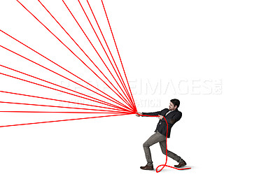 Buy stock photo Shot of a businessman pulling on strings against a white background