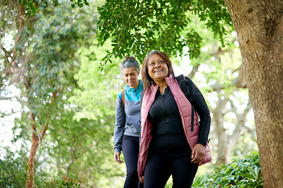 Buy stock photo Shot of two mature women going for a hike in nature