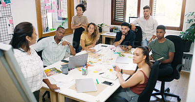 Buy stock photo Shot of a young businesswoman having a brainstorming session with her colleagues in a modern office