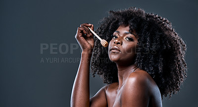 Buy stock photo Shot of a beautiful young woman holding a honey dipper against her face