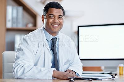 Buy stock photo Portrait of a young doctor working in his office