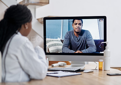 Buy stock photo Shot of a young man having a video call with a doctor on a computer