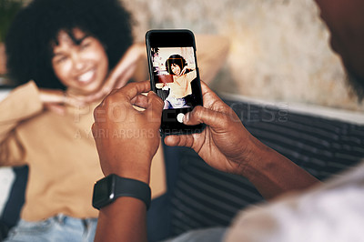 Buy stock photo Shot of a young woman posing while her boyfriend takes photos at home