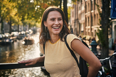 Buy stock photo Shot of a young woman exploring the city of Amsterdam