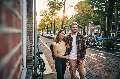 Buy stock photo Shot of a young couple exploring the city of Amsterdam