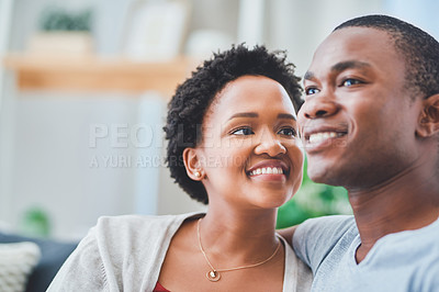 Buy stock photo Cropped shot of a young lady looking endearingly at her partner