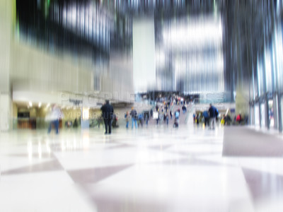 Buy stock photo At the airport - motion and lens blurred people