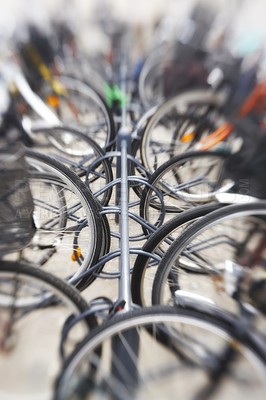 Buy stock photo A lens blurred photo of lots of parked bikes. Useful as background.