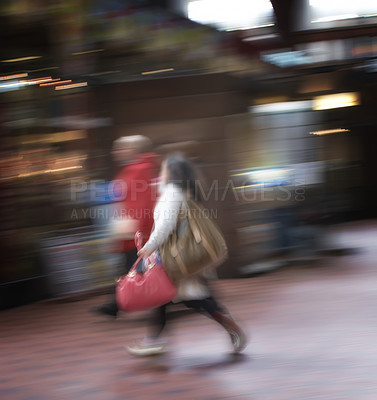 Buy stock photo A motion blurred photo of Busy people travelling