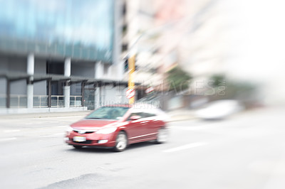 Buy stock photo A lens and motion blurred image of a car in the city