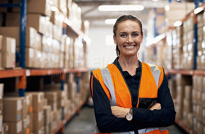 Buy stock photo Portrait of a young woman standing in a warehouse