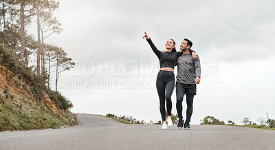 Buy stock photo Full length shot of two young athletes walking with their arms around each other after a run outdoors