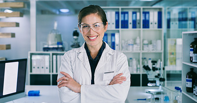 Buy stock photo Portrait of a young woman standing with her arms crossed in a lab