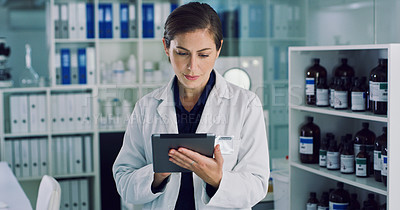Buy stock photo Shot of a young woman using a digital tablet in a lab