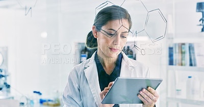 Buy stock photo Shot of a young scientist using a digital tablet while going through notes on a glass screen in a lab