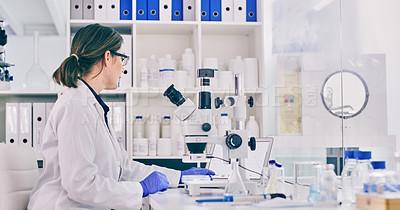 Buy stock photo Shot of a young woman working on a laptop in a lab