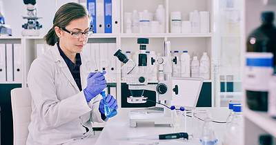 Buy stock photo Cropped shot of a female scientist working in her laboratory