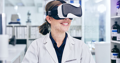 Buy stock photo Shot of a young woman using a virtual reality headset while working in a laboratory