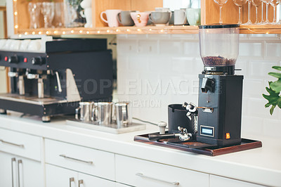 Buy stock photo Shot of a coffee maker on a counter in an empty cafe