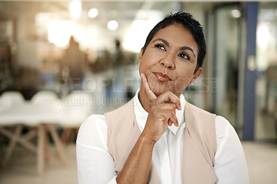 Buy stock photo Shot of a mature businesswoman looking thoughtful in an office