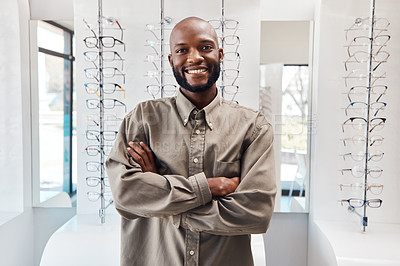 Buy stock photo Portrait of a confident young man working in an optometrist's office