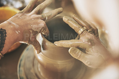 Buy stock photo Shot of an unrecognisable woman working with clay in a pottery studio