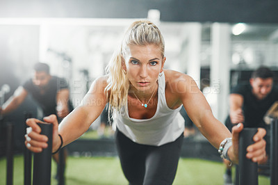Buy stock photo Shot of a woman pushing a weight sled in a gym