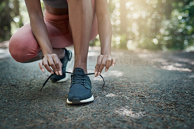 Buy stock photo Shot of an unrecognizable person stretching outside