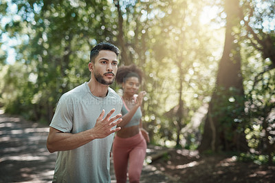 Buy stock photo Shot of two people exercising outdoors