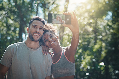 Buy stock photo Shot of two people taking photos after a workout