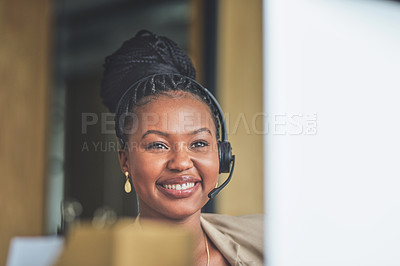 Buy stock photo Shot of a young businesswoman sitting at her desk in her office