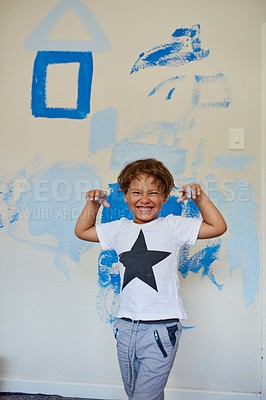 Buy stock photo Shot of a little boy getting his hands dirty while painting a room blue