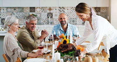 Buy stock photo Shot of two couples sitting down for lunch at home
