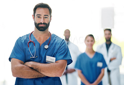 Buy stock photo Cropped portrait of a handsome mature male doctor standing in the hospital