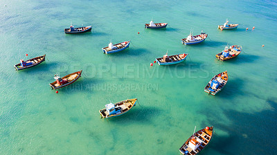 Buy stock photo Drone shot of boats anchored in tranquil clear waters