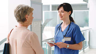 Buy stock photo Shot of a female doctor speaking to a patient in a hospital