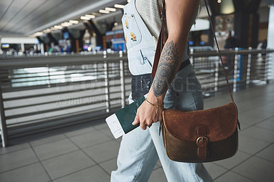 Buy stock photo Cropped shot of a woman on her way to board her flight at the airport